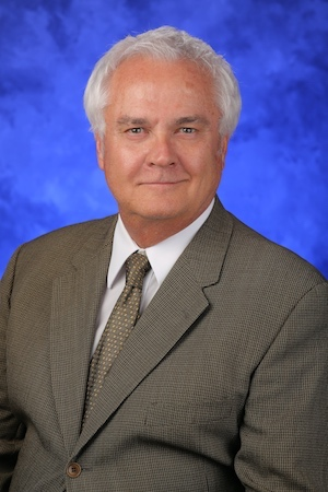 A head-and-shoulders photo of James Connor, MS, PhD